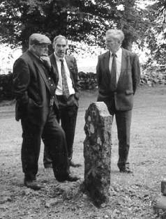 """Let me think now... probably 1735..."" Jimmy Hennessy, Micheal Heery and Johnny Gibney in Killeagh Graveyard."